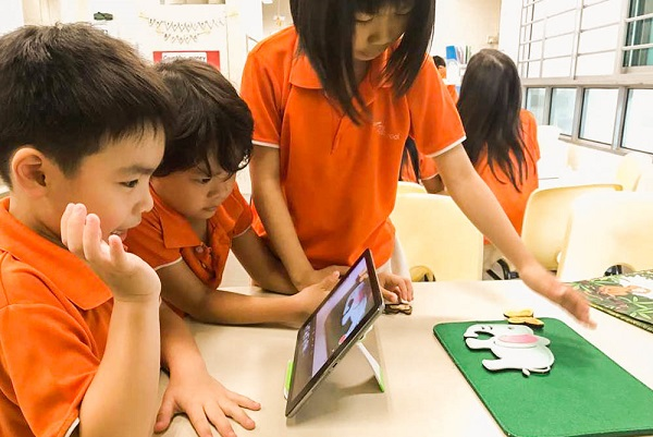 Children learning stop motion animation