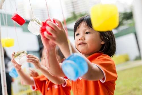 signs of anxiety in preschool, girl engaged in sensory play