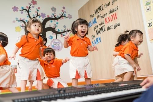 happy children jumping at the best preschool in singapore