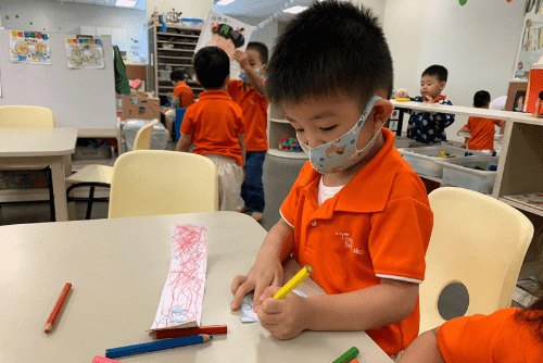 my first skool child making his own paper lantern for mid autumn festival